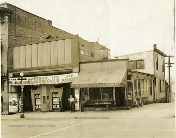 'Second arcade building on High St.  Mooney in white shirt, manager soda grill fruit market'