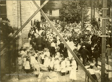 Large crowd gathered for a church dedication (probably Wesley Methodist, corner of High Street and Willey Streets), Morgantown, W. Va.