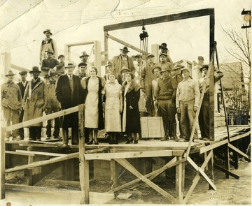 Large group of people standing on the Heiskell Hospital foundation, Morgantown, W. Va. 'Howard Straight.'