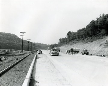 Workers constructing a four-lane highway south of Morgantown, W. Va.