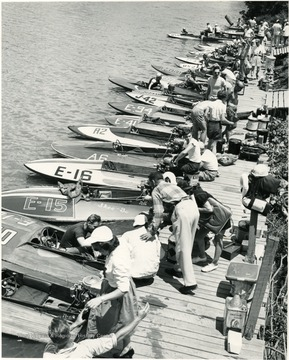 Boats are lined up against the dock.