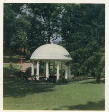 'Marking the site of the famous White Sulphur Springs, Greenbrier county, is this famed rotunda. It is located on the grounds of the Greenbrier hotel.'