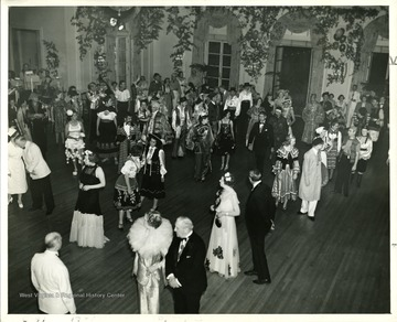 People are dancing at the Old White Fancy Dress Ball 'held annually during Old White Week.'