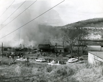 Crowds gather to watch the extinguishing of Glass Plant Fire in Star City near Morgantown, W. Va.