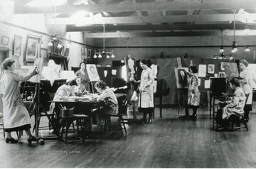 Women seen working on paintings at the Mt. de Chantal Academy in Wheeling, W. Va.