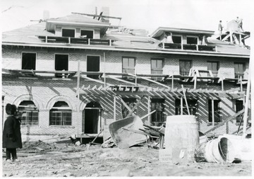 'Constructing the Geo. C. Sturgiss home, corner of Kirk and High Streets, was located behind the present Post Office building.  Photo was taken by Mrs. Geo. C. Sturgiss.  Child in photo is probably Roberta Sturgiss.'