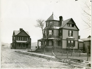 'The home of the late Prof. W. P. Willey on the south-west corner of Pleasant and Spruce Streets.  Prof. Willey for a number of years was the editor of the W. Va. Bar.  Many of his articles were written in this home.  The small residence to the left is the home of Miss Hattie Tennant.  These homes were built about 1885.'