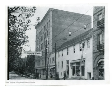 'Before 1927, High and Fayette Street. Strand Theater on right burned down on October 14, 1927.' Sign across the street says 'Window Display of Scranton Schools, Jolliffes Store'.