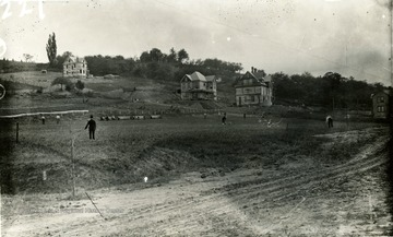 Construction of houses on fraternity row can be seen along dirt road which is High Street in Morgantown, W. Va.