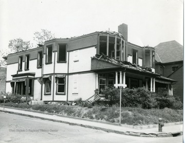 'Old house north east corner of Fayette and Chestnut Streets being razed for city parking lot in Morgantown, West Virginia.'