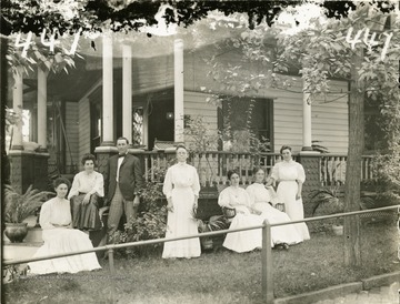 'A group of five ladies and one gentleman at some residence. Probably the Madeira house at the intersection of Beverly Avenue and University Driveway. (Mrs. Madeira standing center)'.