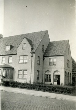 View of the R.M. Davis Home located in Morgantown, W. Va. A girl seen at left near window.