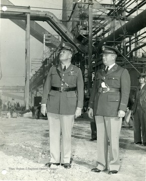 'Colonel Leslie R. Groves, chief of the operations Branch, Washington, D. C. Major Fred O. Mitchell, Deputy zone constructing quartermaster.' Picture taken at Morgantown Ordnance Works in Morgantown, West Virginia. <br /><br /><br /><br />