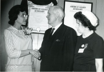 Congressman Harley Staggers seen with members of the American Legion Auxiliary. 'Woman on right is Marguerite Hess.'