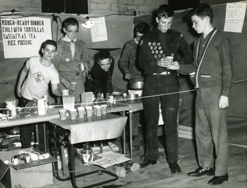 Boy scouts work concession stand. 'Second from right is David Garlow and far right is Alvin Volker.'