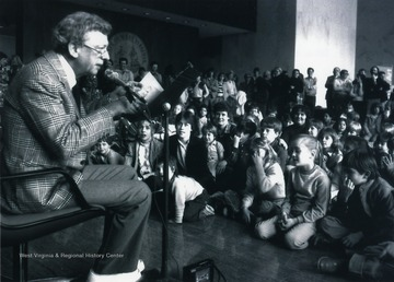 'Don Knotts regales a youthful audience with tales from intrigue and mystery during a special visit to West Virginia University in the 1970s. Knotts, who worked for WVU when he was a student here in the 1940s, has returned many times to give back to his alma mater.