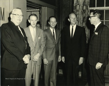 Don Knotts standing among other men.  Far right is Gerald Coy and far left is Clarence Johnson.