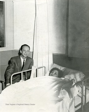 Don Knotts visiting a patient in the hospital.