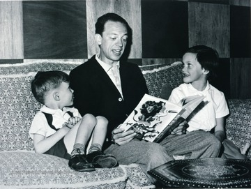 Don Knotts reading a story with his children.