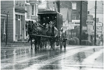 A horse drawn carriage goes down Beechurst Avenue.