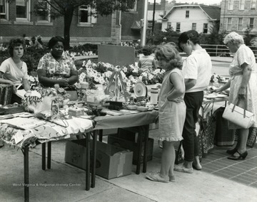 Shoppers browse the sale at the Courthouse in Morgantown, West Virginia.