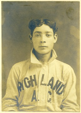 Young man is wearing a baseball uniform that says 'Highland A. C.'