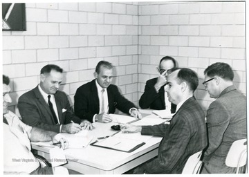 'From left to right: Unknown, Sam Boyd, Harold Shamberger, unknown, Robert Slonniker, unknown.'