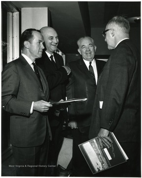Second from the left is Ernest V. Nesius.  On the far right is John Sherlacher.