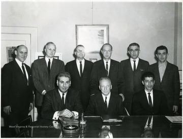 Robert Nestor(standing far left) and Howard Smith (seated third from left.)