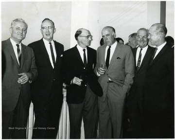 Dyke Raese (fourth from left, holding drink.)