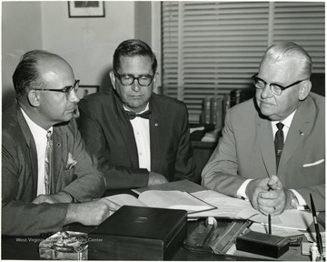 Unknown man with Senator Moreland and Clarence Johnson.