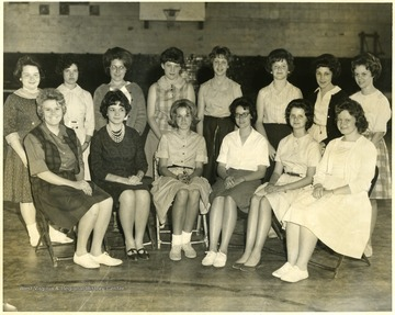 A group portrait of the Girls' Glee Club of Riverside Junior High School. Seated left to right are: Cheryl Moats, Sharon Toothman, Bettie Lofstead, Jessie Beach, Cindy Kurcaba (accompanist) and Karen Newbraugh (accompanist). Standing left to right are: Jennifer Steele, Judy Calvert, Julia Lakatos, Priscilla Pratt, Linda McMillen, Delania Johnson, Linda Kimble, and Kathy Staggs.