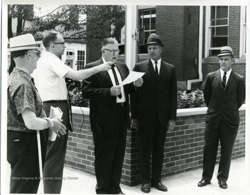 Right to left: Robert Nestor, Charles Whiston, Charles A. Stevenson (speaker,) Jack Johns, and Earl Fisher