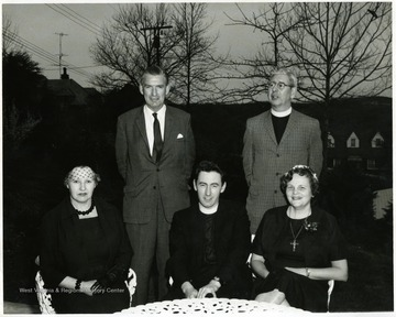 Rev. Chapman and his wife are the couple on the right.