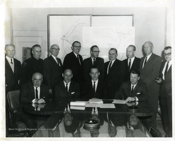 Seated, left to right: Dyke Raese, Robert Nestor, Berkeley Lilley, Harry Heflin.  Standing, at far left, Howard Smyth; second from left, John Lewis; fourth from left, Dean Chester Arents; far right Bill Leyhe.