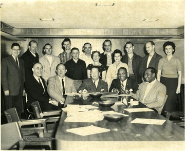 'Mr. Ruby seated center'.
