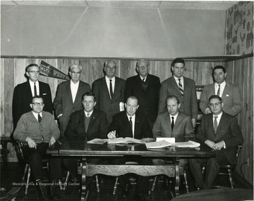 Standing, left to right, Clifford Brown, Bradford Laidley, William A. Townes, Dean Paul Selbey, James R. McCartney.  Seated at far left is Glenn Thorne.