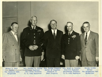 A group portrait of five men. Left to right: 'Walter L. Hart, Editor, The Dominion News, Morgantown; Col. Paschal N. Strong, Division Engineer Ohio River Division, U.S. Army Engineers; Hon. Harley Staggers, Member of Congress District II West Virginia; Col. Ralph A. Lincoln, District Engineer, Pittsburgh District U.S. Army Engineers; and Brooks Cottle, Editor The Morgantown Post.'