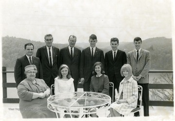 In the front row on the far left is Mrs. Chico.  Back row, from left to right:  Sam Chico Jr., Geral Sherry and Glen Finn.  All others unknown.