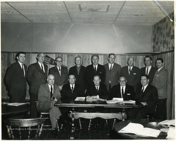 Front row, left to right:  Dyke Raese, William Dyer, unknown, Mr. Courtney and unknown.  Back row, left to right:  Chas. Haden, unknown, unknown, Howard Smyth, unknown, unknown, unknown, Burkey Lilley and James R. McCartney.