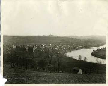 'University and Morgantown (about 1891-92. No Science Hall then; Clock on Martin Hall; Walnut Street had a dead end with the Firehouse seen beyond Martin Hall; Monongalia Academy at the site of the Junior High School; site of Grand Street in  the distance beyond the Academy; Suspension Bridge across the river. 6-1/2 x 8-1/2 inch negative by John L. Johnston, enlargement by Molby (1938).'