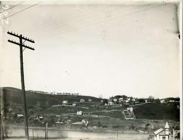 'View of the West Side taken from West Virginia University. Shows the West Side Brickyard before the railroad was built over there. Also of view of Keck's Hill with the orchard on it.'