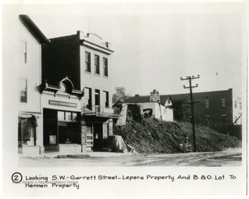 'Looking South West on Garrett Street-Lepera Property and Baltimore and Ohio Railroad Lot to Hennen Property.'
