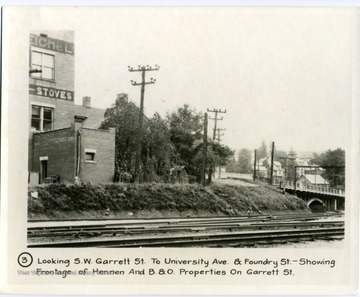 'Looking South West Garrett Street to University Avenue and Foundry Street-showing frontage of Hennen and Baltimore and Ohio Properties on Garrett Street.'