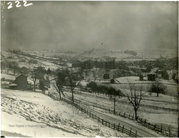 View looking over snow covered fields at Morgantown from Sunnyside.