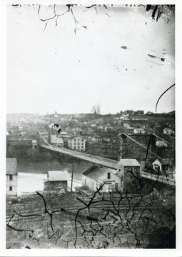 A view of Morgantown, West Virginia. 'The courthouse is shown with two stories-this may date the photo, pre-1868, post 1851. I believe that this print is reversed-note position of Morgantown Academy.'