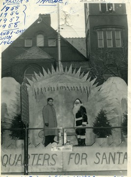 Russel L. Long and his helper standing by 'Santa's Throne' on the courthouse square in Morgantown, W. Va.