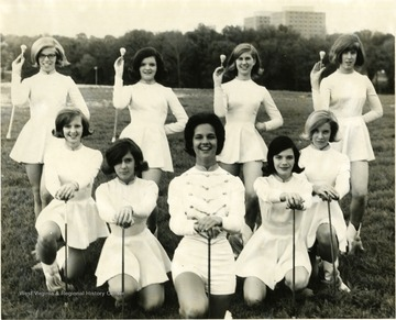 A photo of Suncrest Jr. High School Majorettes. First row from left to right is Harriet Harworth, Karen Suarez, Katy Muffly, Pam Gorman, and Nikki Dorhavich. Second row from left to right is Charlene Hockenberry, Katharine Pike, Kay Toben, and Nancy Fleming.