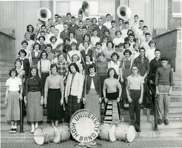 Group portrait of band members with their instruments.