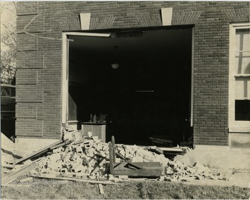 Truck is gone.  Picture displays the damage to the side of the school building.